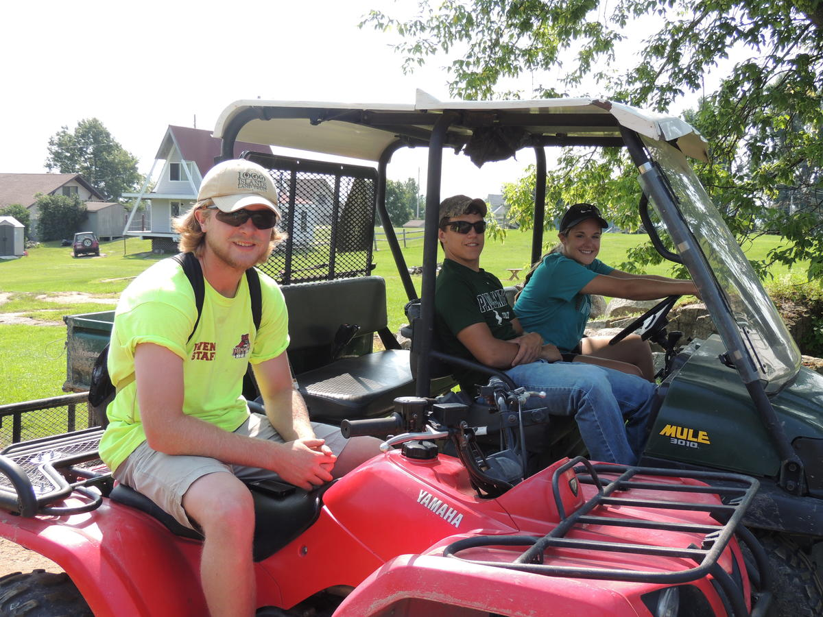 2015 TILT Summer Land Stewards and Summer Land &Volunteer Stewardship Intern assisting with the Grindstone Island Mule Tour (L-R) Rob Kunz, Joey Morris & Hope VanBrocklin