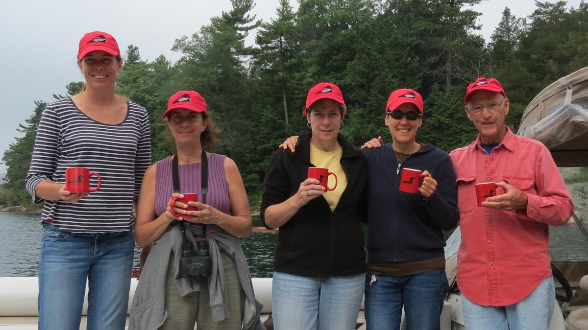 The Loon Crew (l to r) Kate Breheny, Debbie Heineman, Ann Grobe, Robin Hoffman, and Bill Munro sport their loon swag after a successful 2015 census.