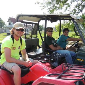 2015 TILT Summer Land Stewards and Summer Land &Volunteer Stewardship Intern assisting with the Grindstone Island Mule Tour (L-R) Rob Kunz, Joey Morris & Hope VanBrocklin