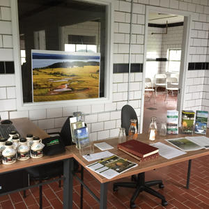 Welcome center with desk, brochures, maple syrup